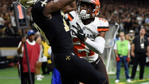 <p>               New Orleans Saints wide receiver Michael Thomas, left, scores a touchdown over Cleveland Browns cornerback Denzel Ward during the second half of an NFL football game in New Orleans, Sunday, Sept. 16, 2018. (AP Photo/Bill Feig)             </p>