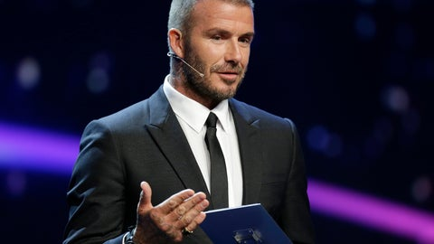 <p>               UEFA President's Award winner David Beckham gestures as he speaks on stages during for the UEFA Champions League draw at the Grimaldi Forum, in Monaco, Thursday, Aug. 30, 2018. (AP Photo/Claude Paris)             </p>