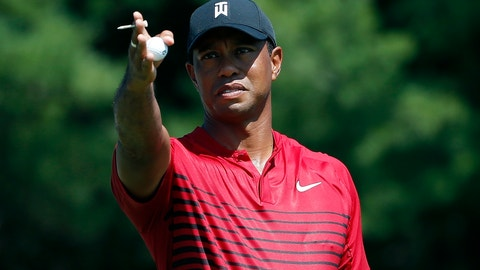 <p>               FILE - In this Monday, Sept. 3, 2018, file photo, Tiger Woods indicates the direction of the wind before teeing off on the third hole during the final round of the Dell Technologies Championship golf tournament at TPC Boston in Norton, Mass. Woods once took for granted that he would end his season at the Tour Championship. Now, just being at East Lake feels like an accomplishment. (AP Photo/Michael Dwyer, File)             </p>