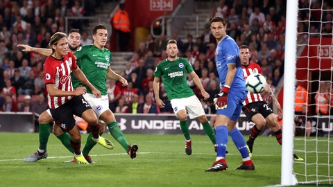 <p>               Brighton & Hove Albion's Shane Duffy, 2nd left, scores his side's first goal of the game against Southampton during their English Premier League soccer match at St Mary's in Southampton, England, Monday Sept. 17, 2018. (John Walton/PA via AP)             </p>