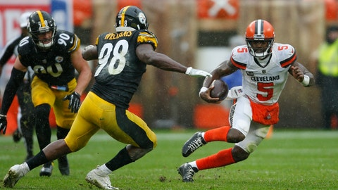 <p>               Cleveland Browns quarterback Tyrod Taylor (5) scrambles against Pittsburgh Steelers linebacker Vince Williams (98) during the first half of an NFL football game, Sunday, Sept. 9, 2018, in Cleveland. (AP Photo/Ron Schwane)             </p>