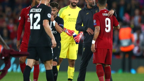 <p>               Liverpool's coach Juergen Klopp hugs Liverpool's Roberto Firmino at he end of the match after he scored his sides third goal during the Champions League Group C soccer match between Liverpool and Paris-Saint-Germain at Anfield stadium in Liverpool, England, Tuesday, Sept. 18, 2018. Liverpool won the match 3-2. (AP Photo/Dave Thompson)             </p>