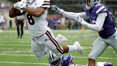 <p>               Mississippi State running back Kylin Hill (8) gets past Kansas State defensive backs AJ Parker (12) and Kendall Adams (21) to score a touchdown on a 16-yard run during the first half of an NCAA college football game Saturday, Sept. 8, 2018, in Manhattan, Kan. (AP Photo/Charlie Riedel)             </p>