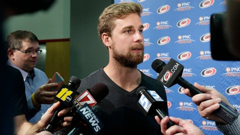 <p>               Carolina Hurricanes' Calvin de Haan takes questions from members of the media during the NHL hockey team's media day in Raleigh, N.C., Tuesday, Sept. 4, 2018. (AP Photo/Gerry Broome)             </p>