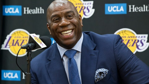 """<p>               FILE - In this Tuesday, June 26, 2018 file photo,Los Angeles Lakers president of basketball operations, Earvin """"Magic"""" Johnson, smiles as he introduces new draft players, Moritz Wagner, originally from Germany, and guard Sviatoslav Mykhailiuk, originally from Ukraine, at the UCLA Health Training Center in El Segundo, Calif. Magic Johnson can already see LeBron James' impact on the young Los Angeles Lakers before they've even had a regular practice together. After just a few weeks of unusually competitive offseason scrimmages, the Lakers' basketball boss can't wait to see how James' leadership will translate into real success.(AP Photo/Damian Dovarganes, File)             </p>"""