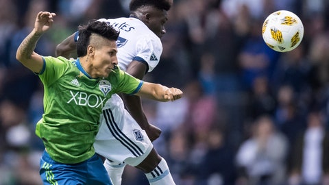 <p>               Seattle Sounders' Raul Ruidiaz, front, and Vancouver Whitecaps' Alphonso Davies vie for the ball during the first half of an MLS soccer match, Saturday, Sept. 15, 2018, in Vancouver, British Columbia. (Darryl Dyck/The Canadian Press via AP)             </p>