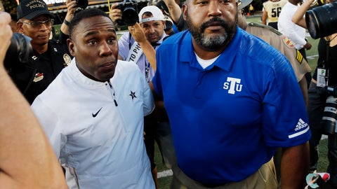 <p>               Vanderbilt head coach Derek Mason, left, and Tennessee State head coach Rod Reed meet on the field after an NCAA college football game Saturday, Sept. 29, 2018, in Nashville, Tenn. Vanderbilt won 31-27. (AP Photo/Mark Humphrey)             </p>