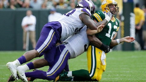 <p>               Green Bay Packers' Aaron Rodgers is hit after throwing during the second half of an NFL football game against the Minnesota Vikings Sunday, Sept. 16, 2018, in Green Bay, Wis. (AP Photo/Mike Roemer)             </p>
