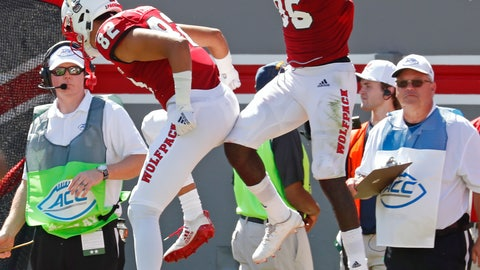 <p>               North Carolina State's Emeka Emezie (86) celebrates his touchdown with teammate Max Fisher (82) during the first half of an NCAA college football game in Raleigh, N.C., Saturday, Sept. 29, 2018. (AP Photo/Chris Seward)             </p>