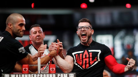 <p>               Geoff Hale, right, of Tulsa, Okla., celebrates his win over Tom Holland, of Slough, Berkshire, United Kingdom, in the lightweight battle royale at the World Armwrestling League Championships in Atlanta, Wednesday, Sept. 5, 2018. (AP Photo/David Goldman)             </p>