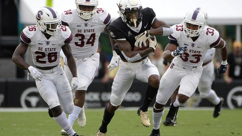 <p>               Central Florida wide receiver Dredrick Snelson runs after catching a pass for a 22-yard gain in front of South Carolina State defensive back Jayden Brunson (26), linebacker Jablonski Green (34) and defensive back Chris Adams (33) during the first half of an NCAA college football game Saturday, Sept. 8, 2018, in Orlando, Fla. (AP Photo/Phelan M. Ebenhack)             </p>