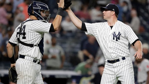 <p>               New York Yankees relief pitcher Zach Britton, right, celebrates with catcher Gary Sanchez after the Yankees defeated the Boston Red Sox 3-2 during a baseball game Tuesday, Sept. 18, 2018, in New York. (AP Photo/Julio Cortez)             </p>