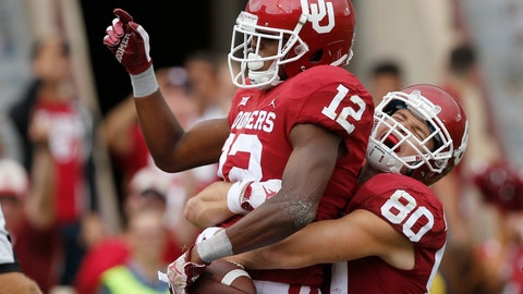 <p>               Oklahoma tight end Grant Calcaterra (80) celebrates with teammate wide receiver A.D. Miller (12) following Miller's touchdown in the second half of an NCAA college football game against UCLA in Norman, Okla., Saturday, Sept. 8, 2018. Oklahoma won 49-21. (AP Photo/Sue Ogrocki)             </p>