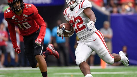 <p>               Mississippi running back Scottie Phillips (22) runs past Texas Tech defensive back John Bonney during the second half of a college football game, Saturday, Sept. 1, 2018, in Houston. Mississippi won 47-27. (AP Photo/Eric Christian Smith)             </p>