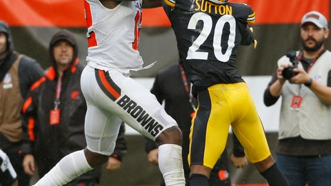 <p>               Cleveland Browns wide receiver Josh Gordon (12) catches a 17-yard touchdown pass under pressure from Pittsburgh Steelers cornerback Cameron Sutton (20) during the second half of an NFL football game, Sunday, Sept. 9, 2018, in Cleveland. (AP Photo/Ron Schwane)             </p>