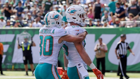 <p>               Miami Dolphins' A.J. Derby (85) celebrates with Danny Amendola (80) after scoring a touchdown during the first half of an NFL football game against the New York Jets Sunday, Sept. 16, 2018, in East Rutherford, N.J. (AP Photo/Bill Kostroun)             </p>