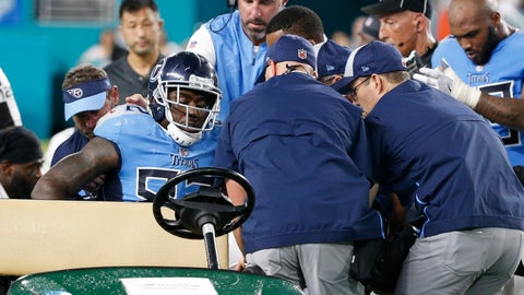 <p>               Tennessee Titans tight end Delanie Walker (82) is assisted on to a cart by the head coach Mike Vrabel and members of the Titans staff, after he was injured on a play, during the second half of an NFL football game against the Miami Dolphins, Sunday, Sept. 9, 2018, in Miami Gardens, Fla. (AP Photo/Wilfredo Lee)             </p>