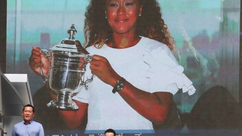 <p>               People walk by a huge screen showing US Open women's singles champion Naomi Osaka with her trophy, in Tokyo, Monday, Sept. 10, 2018. (AP Photo/Koji Sasahara)             </p>