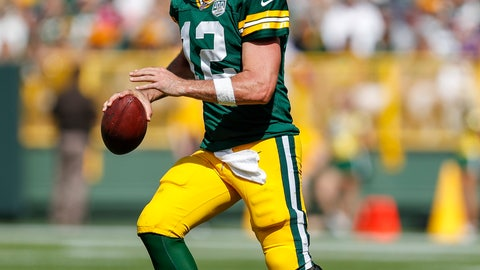 <p>               FILE - In this Sept. 16, 2018, file photo, Green Bay Packers quarterback Aaron Rodgers looks to pass during an NFL football game against the Minnesota Vikings, in Green Bay, Wis. Aaron Rodgers and Adrian Peterson meet again, this time with the Green Bay Packers quarterback battling a knee injury and the running back now 33 and playing for the Washington Redskins. (AP Photo/Matt Ludtke, File)             </p>