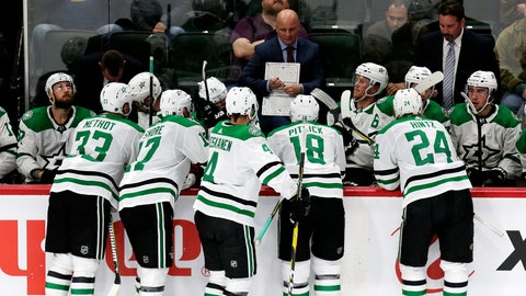 <p>               FILE - In this Sept. 20, 2018, file photo, Dallas Stars coach Jim Montgomery talks to players during a time out against the Minnesota Wild in the third period during a preseason NHL hockey game, in St. Paul, Minn. Montgomery makes the jump from the college ranks (University of Denver), where he had an offensive team. (AP Photo/Andy Clayton-King, File)             </p>