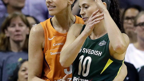 <p>               Phoenix Mercury's Diana Taurasi, left, briefly embraces Seattle Storm's Sue Bird as Bird calls a timeout moments after Taurasi connected on a 3-point shot with seconds left in the second half in a WNBA basketball playoff semifinal, Tuesday, Aug. 28, 2018, in Seattle. The shot sent the game into overtime and the Storm won 91-87. (AP Photo/Elaine Thompson)             </p>