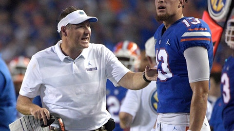 <p>               Florida head coach Dan Mullen, left, talks with quarterback Feleipe Franks (13) on the sideline during the first half of an NCAA college football game against Charleston Southern Saturday, Sept. 1, 2018, in Gainesville, Fla. (AP Photo/Phelan M. Ebenhack)             </p>
