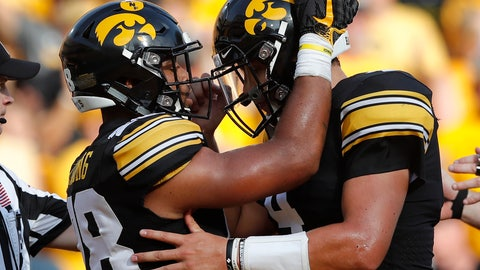 <p>               Iowa running back Toren Young, left, celebrates with quarterback Nate Stanley after scoring on a 6-yard touchdown run during the second half of an NCAA college football game against Northern Illinois, Saturday, Sept. 1, 2018, in Iowa City, Iowa. Iowa won 33-7. (AP Photo/Charlie Neibergall)             </p>