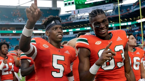 <p>               Miami quarterback N'Kosi Perry (5) and wide receiver Evidence Njoku (83) sing the alma mater after an NCAA college football game against FIU, Saturday, Sept. 22, 2018, in Miami Gardens, Fla. (AP Photo/Lynne Sladky)             </p>