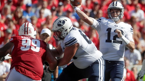 <p>               BYU quarterback Tanner Mangum throws during the first half of an NCAA college football game against Wisconsin Saturday, Sept. 15, 2018, in Madison, Wis. (AP Photo/Morry Gash)             </p>