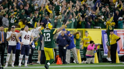 <p>               Green Bay Packers' Aaron Rodgers reacts after throwing a 75-yard touchdown pass to Randall Cobb during the second half of an NFL football game against the Chicago Bears Sunday, Sept. 9, 2018, in Green Bay, Wis. (AP Photo/Mike Roemer)             </p>