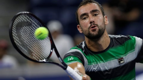 <p>               Marin Cilic, of Croatia, returns a shot against Alex de Minaur, of Australia, in a third-round tennis at the U.S. Open tennis championship, Saturday, Sept. 1, 2018, in New York. (AP Photo/Mark Lennihan)             </p>