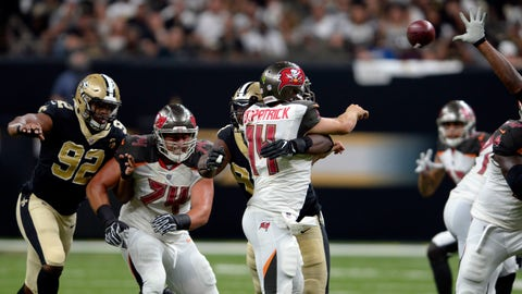 <p>               New Orleans Saints defensive tackle David Onyemata commits a late hit on Tampa Bay Buccaneers quarterback Ryan Fitzpatrick (14) which resulted in a penalty and a scuffle in the second half of an NFL football game in New Orleans, Sunday, Sept. 9, 2018. (AP Photo/Bill Feig)             </p>