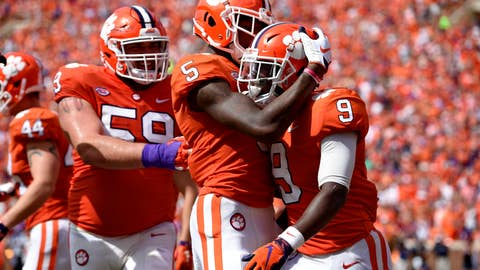 <p>               Clemson's Travis Etienne (9) celebrates his touchdown with Tee Higgins (5) and Gage Cervenka during the second half of an NCAA college football game against Syracuse, Saturday, Sept. 29, 2018, in Clemson, S.C. Clemson won 27-23. (AP Photo/Richard Shiro)             </p>