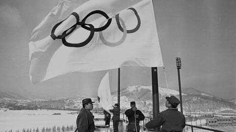 <p>               FILE - In this Jan. 23, 1972, file photo, members of Japan's self-defense ground forces raise Olympic Flags in Sapporo at Makomanai speed skating stadium in a rehearsal of ceremony at the official opening of Winter Olympic. The Japanese city of Sapporo is expected to withdraw from bidding for the 2026 Winter Olympics. This would leave four candidates as the International Olympic Committee finds it increasingly difficult to find hosts, particularly for the Winter Olympics. The IOC will name the winning bidder a year from now. The four remaining are: Stockholm, Sweden; Calgary, Canada; Turin, Milan, and Cortina d'Ampezzo, Italy; Erzurum, Turkey. (AP Photo, File)             </p>