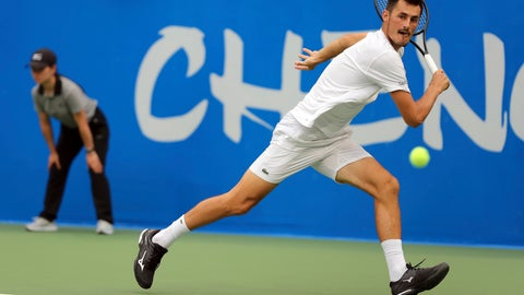 <p>               Bernard Tomic of Australia hits a return shot against Joao Sousa of Portugal during their semifinal match in the ATP 250 Chengdu Open tennis tournament in Chengdu in southwestern China's Sichuan province, Saturday, Sept. 29, 2018. Tomic beat Sousa, 2-0. (Chinatopix via AP)             </p>