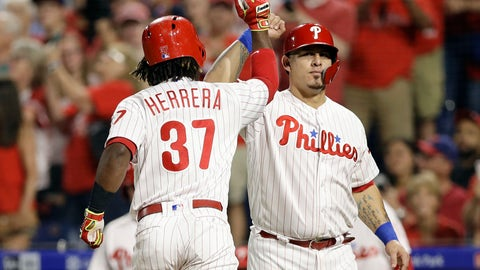 <p>               Philadelphia Phillies' Wilson Ramos, right, and Odubel Herrera celebrate after Herrera's two-run home run off New York Mets starting pitcher Noah Syndergaard during the first inning of a baseball game, Wednesday, Sept. 19, 2018, in Philadelphia. (AP Photo/Matt Slocum)             </p>