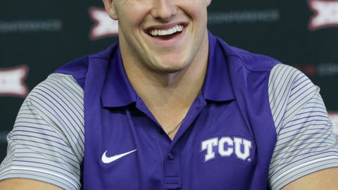 <p>               FILE - In this July 17, 2017, file photo, TCU linebacker Ty Summers laughs while speaking with reporters during the Big 12 NCAA college football media day in Frisco, Texas. Summers was an all-district dual-threat quarterback in high school. Since he started playing for No. 15 TCU, Summers has been on the other side chasing quarterbacks and making tackles all over the field. (AP Photo/LM Otero)             </p>