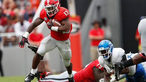 <p>               Georgia running back Elijah Holyfield (13) breaks through the Middle Tennessee defense for a big gain in the first half of an NCAA college football game Saturday, Sept. 15, 2018, in Athens, Ga. (AP Photo/John Bazemore)             </p>