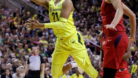 <p>               Seattle Storm's Jordin Canada (21) drives past Washington Mystics' Elena Delle Donne in the first half of Game 2 of the WNBA basketball finals Sunday, Sept. 9, 2018, in Seattle. (AP Photo/Elaine Thompson)             </p>