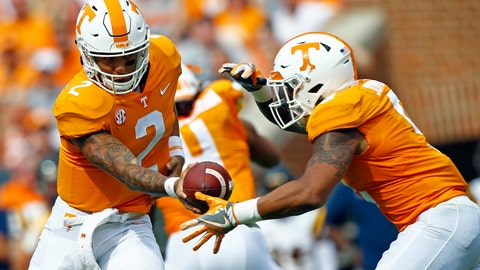 <p>               FILE- In this Saturday, Sept. 8, 2018, file photo, Tennessee quarterback Jarrett Guarantano (2) hands the ball off to running back Tim Jordan (9) during the first half of an NCAA college football game against East Tennessee State University in Knoxville, Tenn. While Guarantano has started Tennessee's first two games at quarterback after beating out Stanford graduate transfer Keller Chryst in the preseason, Tennessee has continued experimenting on the offensive line and running back. (AP Photo/Wade Payne, File)             </p>