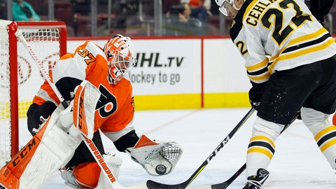 <p>               The puck falls from the glove of Philadelphia Flyers goalie Brian Elliott, left, onto the stick of Boston Bruins' Peter Cehlarik who scored a moment later during the first period of an NHL preseason hockey game, Monday, Sept, 24, 2018, in Philadelphia. (AP Photo/Tom Mihalek)             </p>