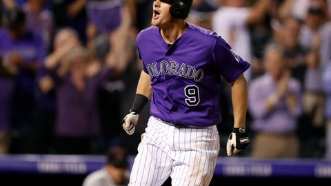 <p>               Colorado Rockies' DJ LeMahieu celebrates as he circles the bases after hitting a two-run home run off Arizona Diamondbacks relief pitcher Yoshihisa Hirano in the ninth inning of a baseball game, Wednesday, Sept. 12, 2018, in Denver. The Rockies won 5-4. (AP Photo/David Zalubowski)             </p>