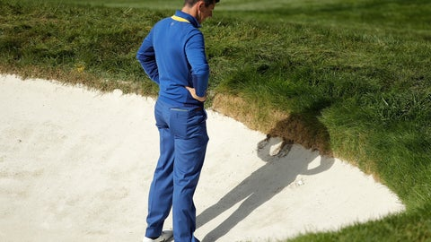 <p>               Europe's Rory McIlroy looks down at his ball in a bunker on the 18th hole during a singles match on the final day of the 42nd Ryder Cup at Le Golf National in Saint-Quentin-en-Yvelines, outside Paris, France, Sunday, Sept. 30, 2018. Europe's Rory McIlroy lost to Justin Thomas of the US. (AP Photo/Matt Dunham)             </p>