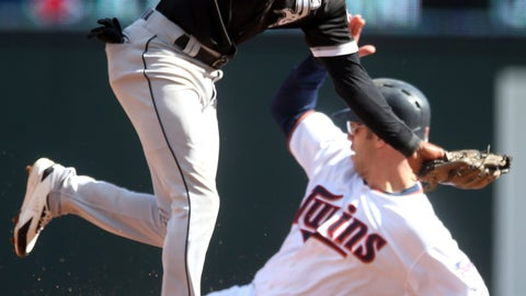 <p>               Chicago White Sox shortstop Tim Anderson, left, runs past Minnesota Twins' Joe Mauer after tagging out Mauer on a steal attempt during the third inning in the first game of a baseball doubleheader Friday, Sept. 28, 2018, in Minneapolis. (AP Photo/Jim Mone)             </p>