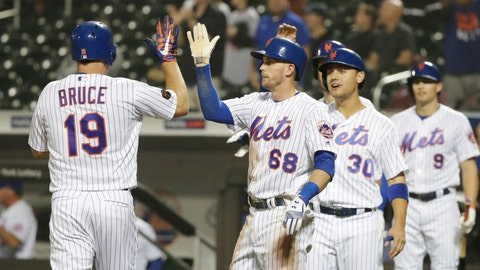 <p>               New York Mets' Jay Bruce (19) celebrates with teammates Jeff McNeil (68) and Michael Conforto (30) after hitting a grand slam home run during the sixth inning of a baseball game against the Miami Marlins Wednesday, Sept. 12, 2018, in New York. (AP Photo/Frank Franklin II)             </p>