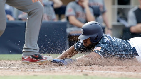 <p>               San Diego Padres' Manuel Margot, right, slides into home safely after Arizona Diamondbacks catcher John Ryan Murphy threw to first to get Francisco Mejia after striking out swinging during the 10th inning of a baseball game in San Diego, Sunday, Sept. 30, 2018. The Padres won 4-3 in 10 innings. (AP Photo/Alex Gallardo)             </p>