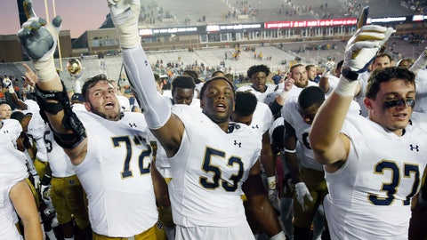 <p>               FILE - In this Sept. 16, 2017, file photo, Notre Dame's Robert Hainsey (72) and Khalid Kareem (53) celebrate with teammates after defeating Boston College 49-20 in an NCAA college football game in Boston. Notre Dame junior Khalid Kareem found himself lost in the defensive line shuffle for most of his first two seasons with the Irish. Always buried on the depth chart, the Detroit native just wanted a chance to prove that he could become a regular contributor, and perhaps even a starter. A late-season surge in 2017 followed by a stellar showing in spring ball earned Kareem his chance at both.(AP Photo/Michael Dwyer, File)             </p>