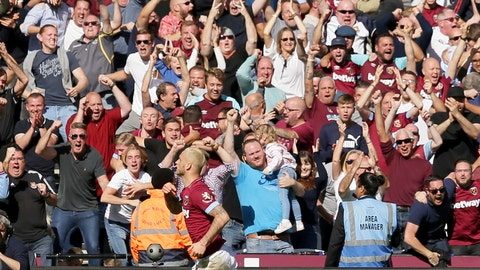 <p>               West Ham's Marko Arnautovic runs past fans to celebrate after scoring his sides third goal during the English Premier League soccer match between West Ham United and Manchester United at London Stadium in London in London, England, Saturday, Sept. 29, 2018. (AP Photo/Tim Ireland)             </p>