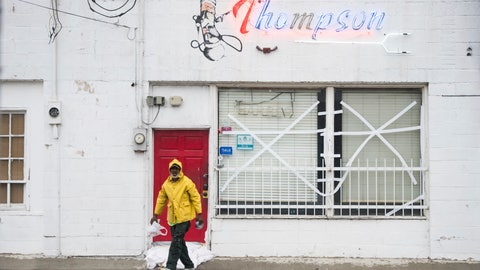 <p>               DL Glenn finishes sandbagging at the door at Thompson Barber Shop as Florence slowly moves across the East Coast Friday, Sept. 14, 2018, in Florence, S.C. The National Hurricane Center said Florence will eventually break up over the southern Appalachians and make a right hook to the northeast, its rainy remnants moving into the mid-Atlantic states and New England by the middle of next week. (AP Photo/Sean Rayford)             </p>
