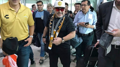 <p>               FILE - In this Sept. 8, 2018 file photo provided by Prensa Club Dorados de Sinaloa, Argentine soccer legend Diego Maradona walks through the airport in Culiacan, Mexico. Maradona, the soccer world's poster child for the perils of substance abuse, is setting up camp to lead a team in the heart of Mexico's drug cartel land. (Prensa Club Dorados de Sinaloa via AP, File)             </p>